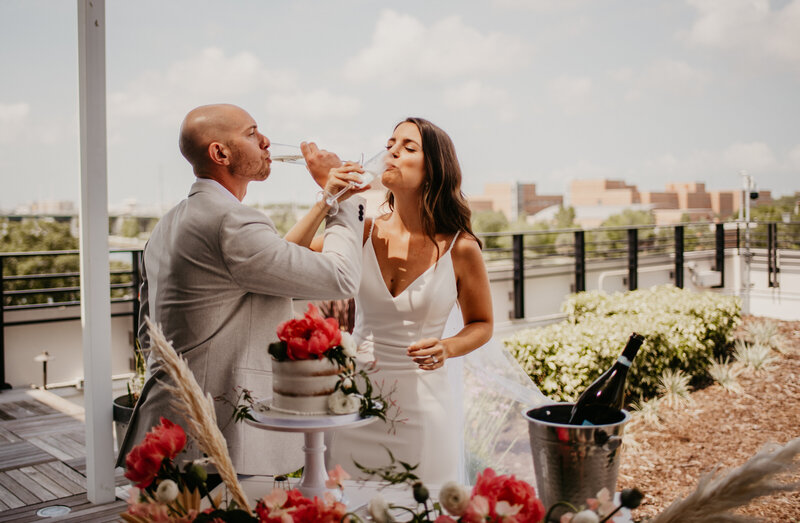 Couple toasting their wedding at Armature Works Rooftop