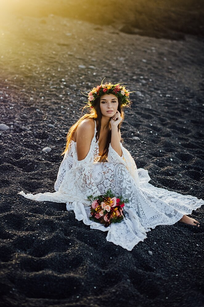 bride on black sand beach in hawaii