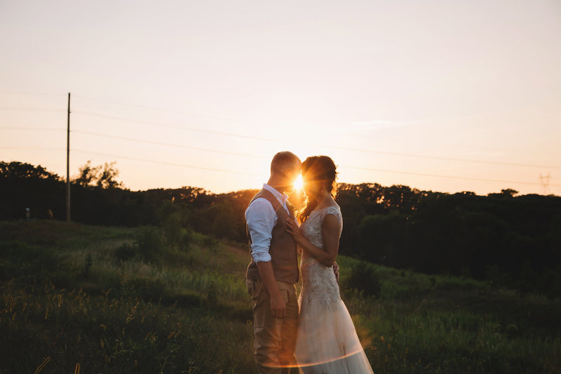 Bride and Groom in front of sunset  located in  Iowa  plains