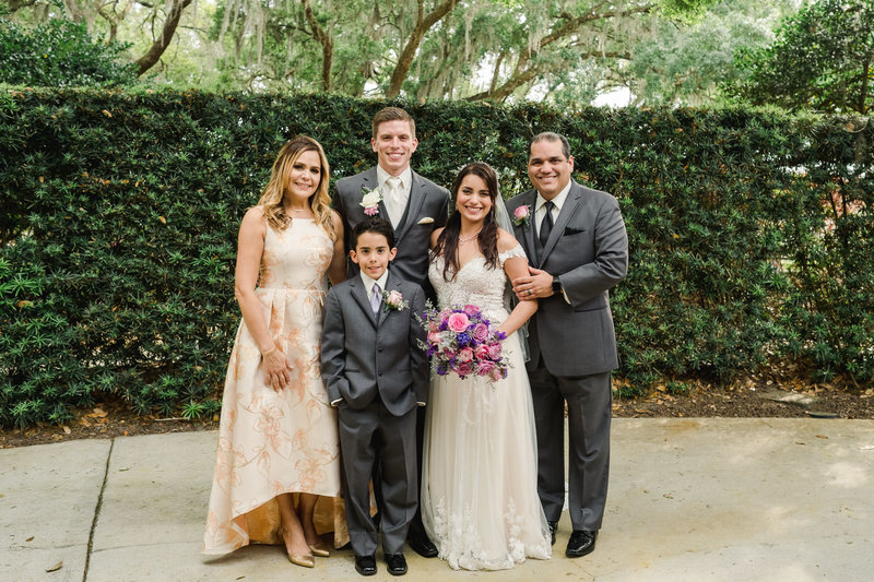 Family of bride in front of greenery at Club Lake Plantation