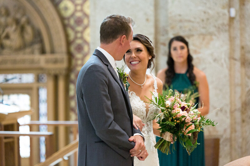 bride and groom smiling during downtown detroit catholic wedding