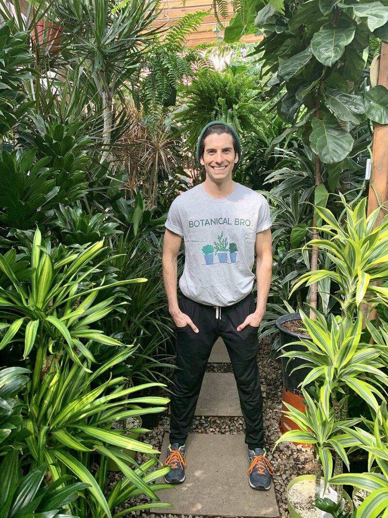 man smiles wearing a Botanical Bro tshirt