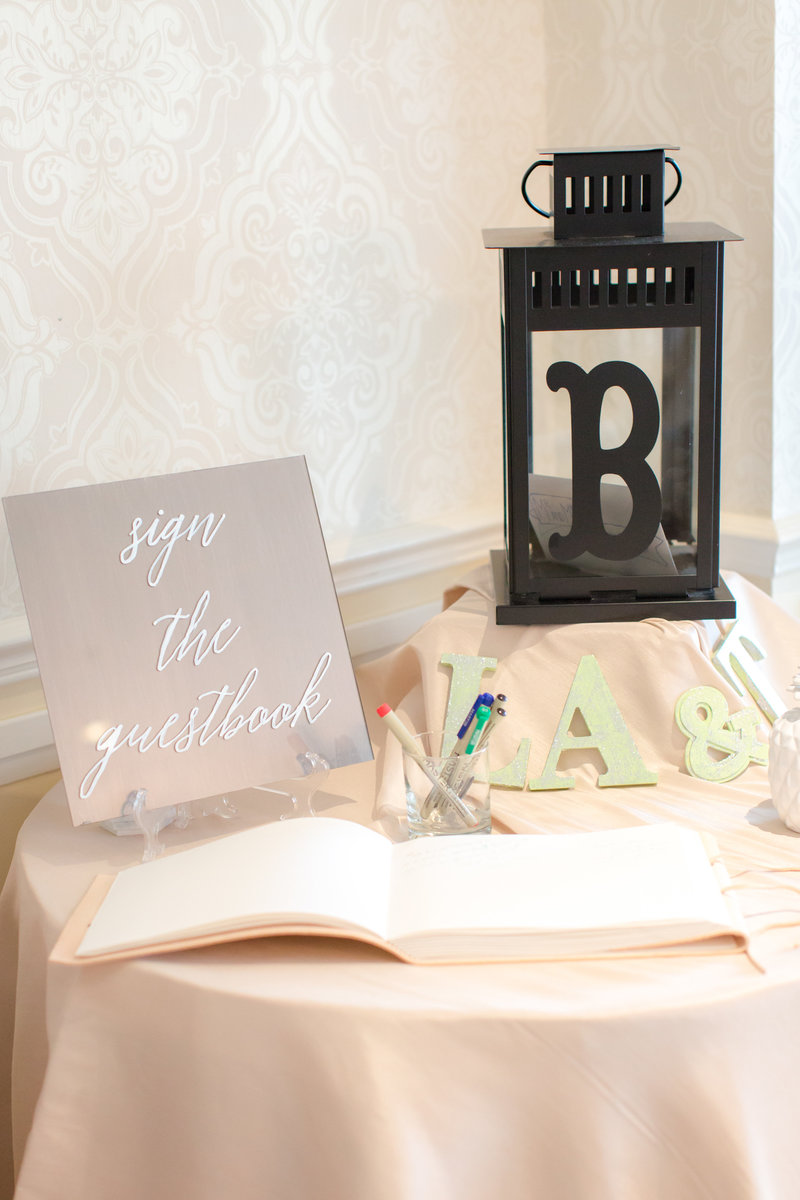 Guest book with mirrored sign