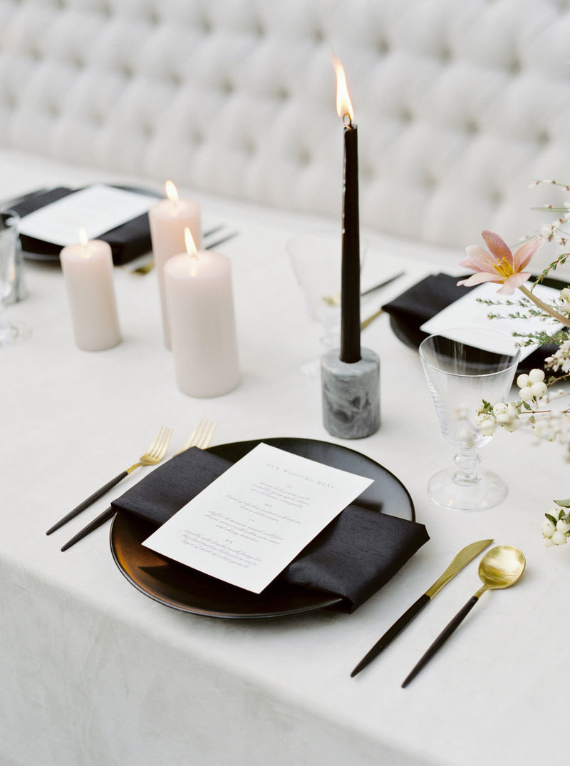 Black Plate and Napkin with White Menu and Gold Flatware