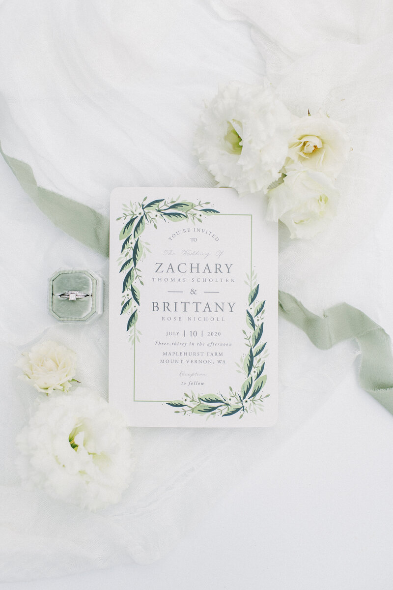 wedding invitation in white and sage green