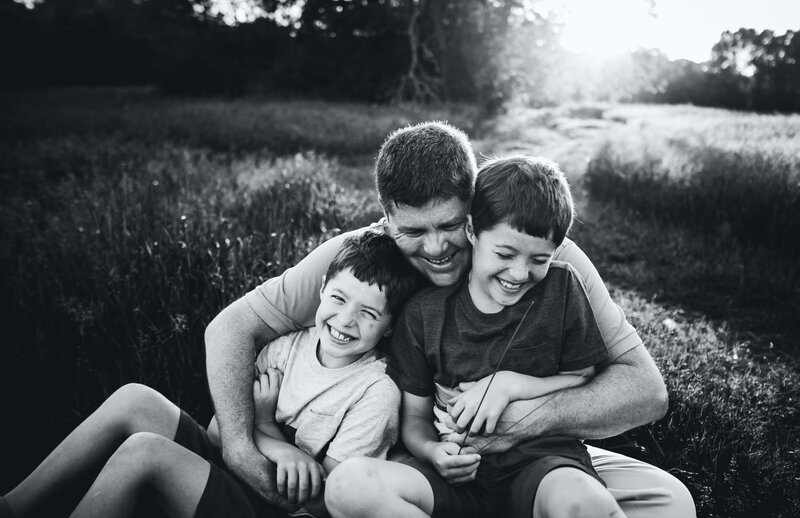 Boston Family Photographer dad hugging boys