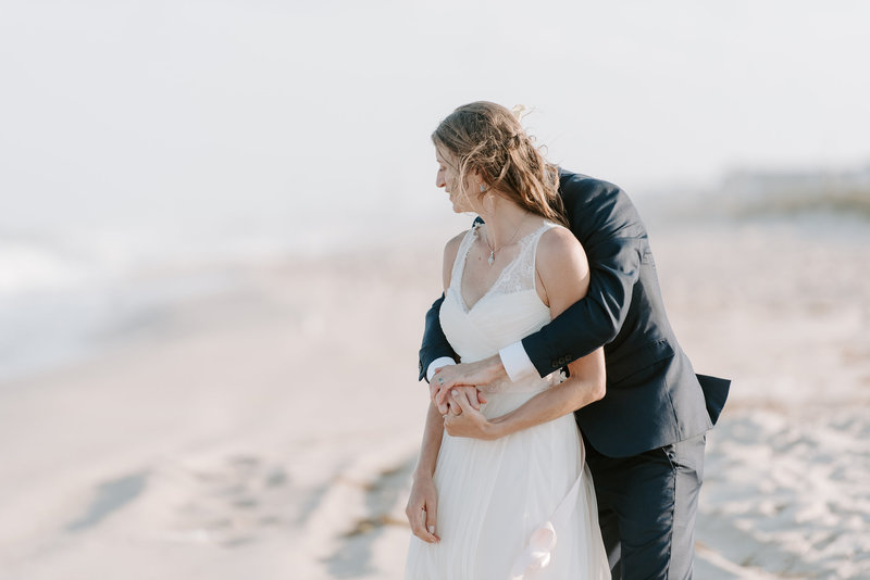 bride and groom have special moment during portraits on the beach