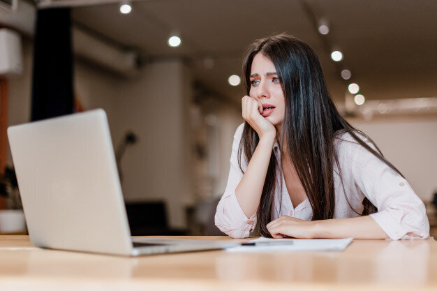 stressed-scared-confused-woman-using-laptop-office_97712-696