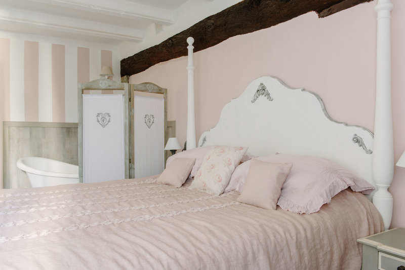 Bed decorated with Arte Pura Italian linens , 'For the Love of Tan' chalk paint on the wall, realised by Arte di Vita Interiors.