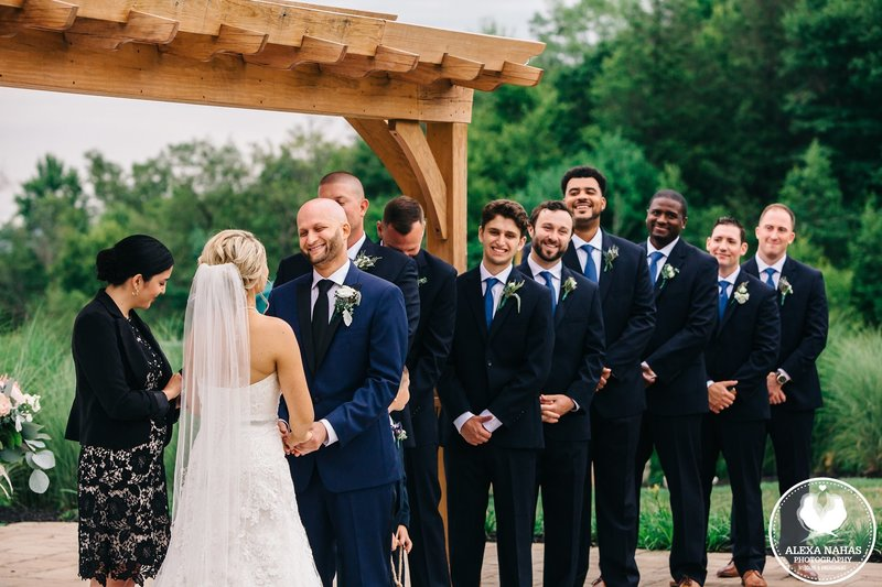 The groomsmen love the ceremony at Blue Mountain Resort! The couple chose Cely Santana of Lehigh Valley Celebrants for their wedding officiant.