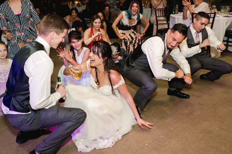 couple getting low on the dance floor at their Club Lake Plantation Wedding reception