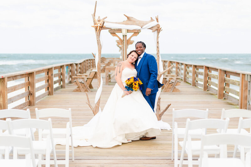 wedding ceremony at kitty hawk pier house weddings