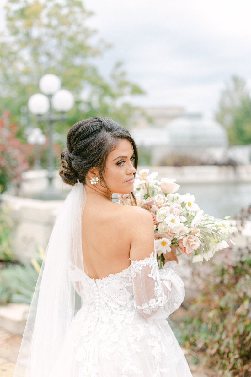 bride looking over her shoulder at Washington DC Romantic Classic Wedding at the Lincoln Memorial by Costola Photography