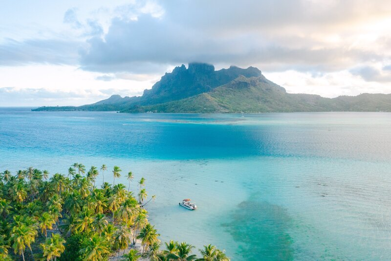 Drone Photography view on the Mount Otemanu in Bora Bora and the blue lagoon - boat trip