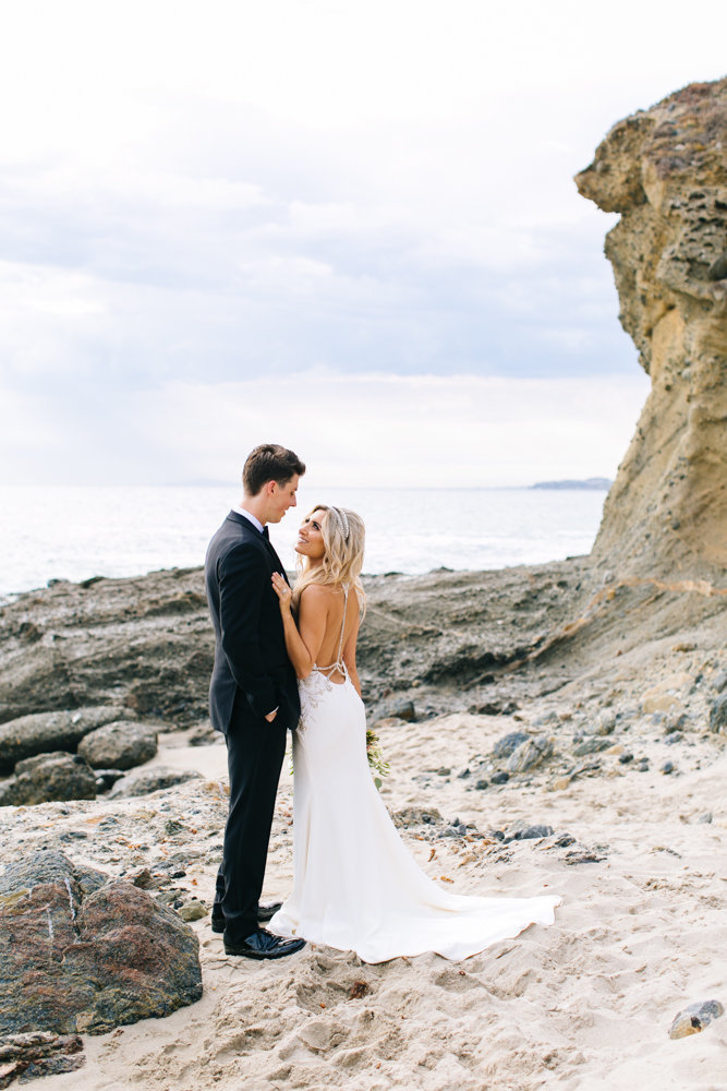 bride and groom on the beach in laguna beach montage resort