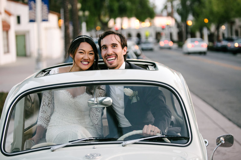 couple in car smiling in san Gabriel  grapevine arbor wedding venue