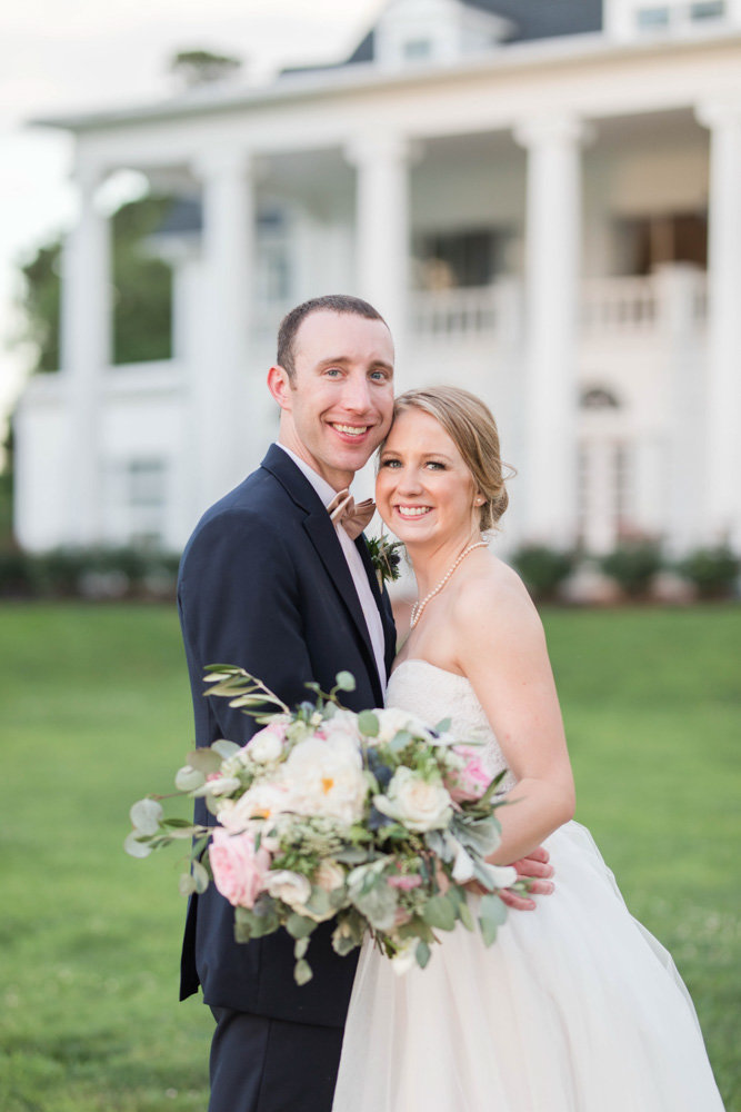 couple in front of manor at eastern shore wedding at kirkland manor by costola photography