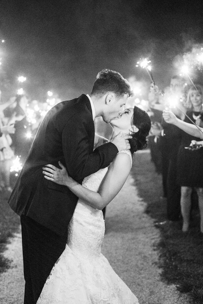 couple kissing during sparkler exit at springfield manor winery and distillery wedding by costola photography