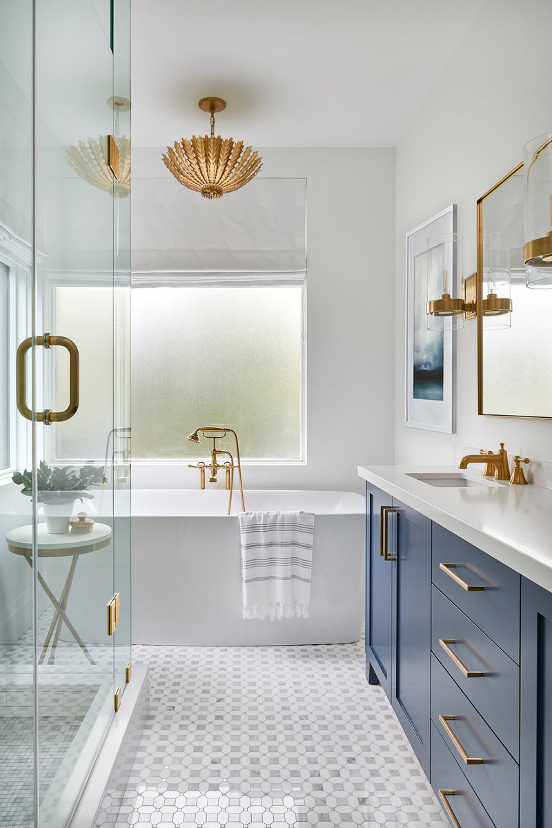 beautiful bathroom with tub and blue vanity in Toronto home