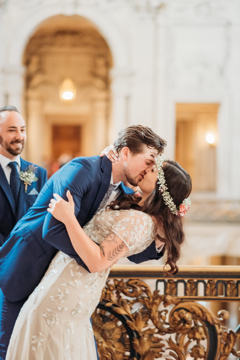 The first kiss at San Francisco City Hall  Photographer Mayors Balcony Wedding