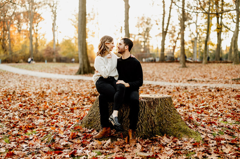 engaged couple in woodsy park