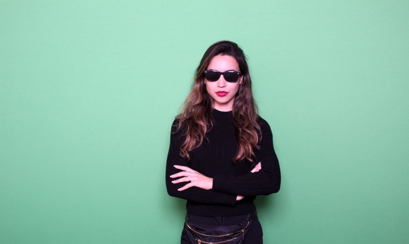 woman posing front of a green screen