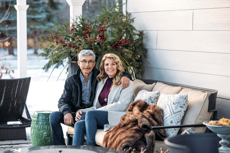 couple sitting on cozy sofa outdoors in winter