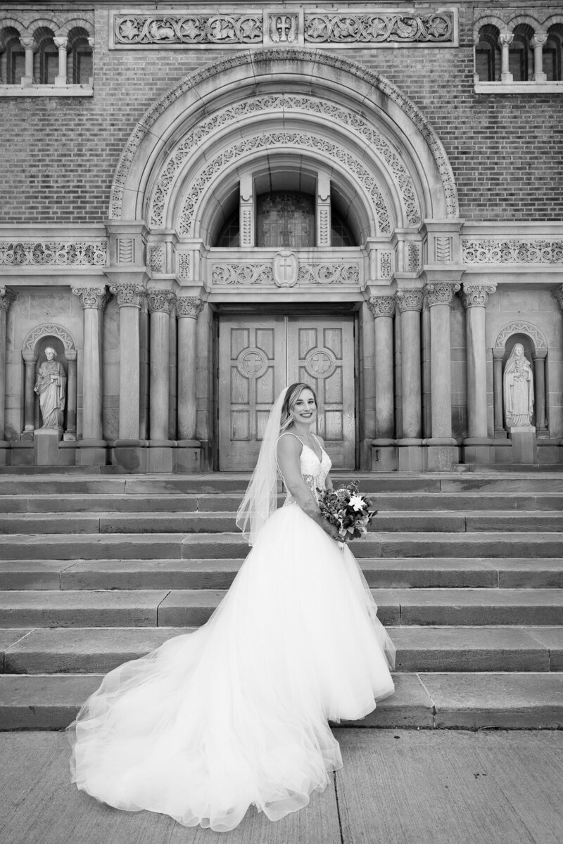 bride and groom portrait outside of st. john cantius church
