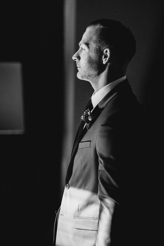 reno wedding photographer groom waits to walk down aisle