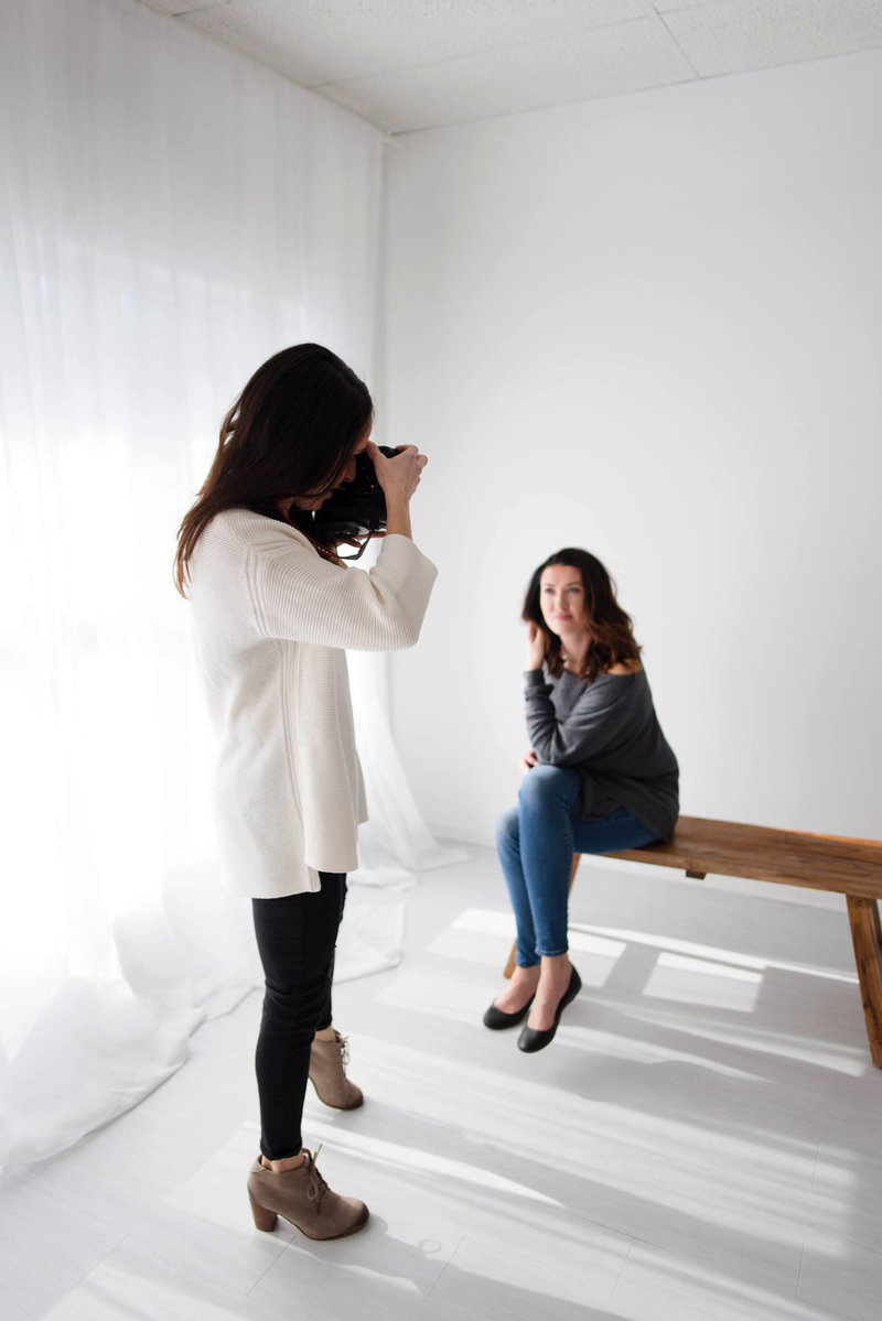 Chicago family photography by Elle Baker Photography shows a behind the scenes photo of her photographing a client