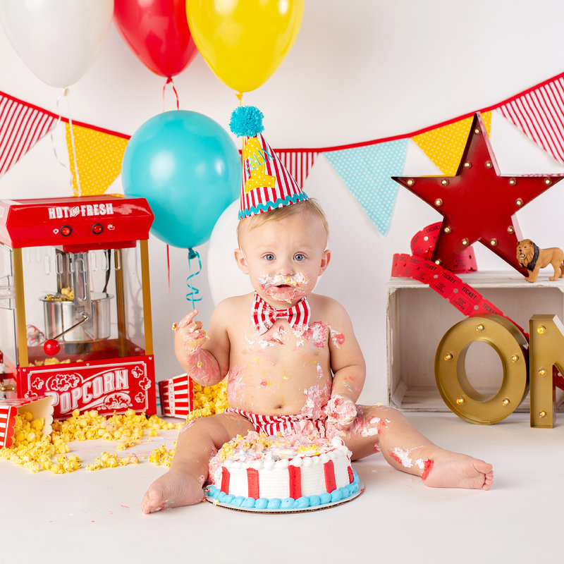 Baby boy first birthday circus themed cake smash
