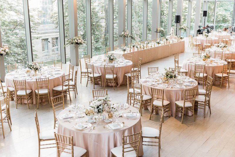 Pink table cloths and gold chair at the beautiful summer wedding at the royal conservatory of Toronto