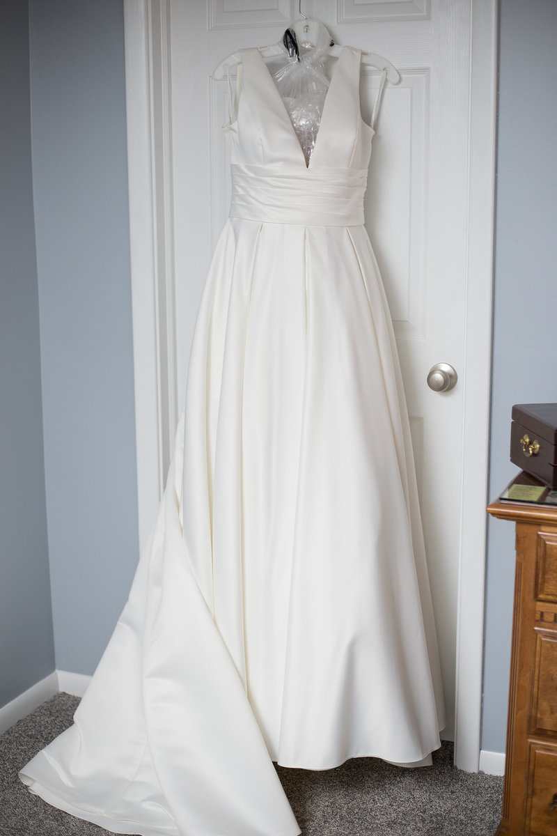 Portrait of hanging wedding gown
