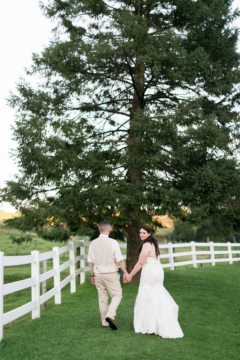Wedding couple with white picket fence