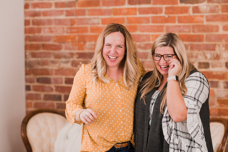 Female entrepreneurs laughing together