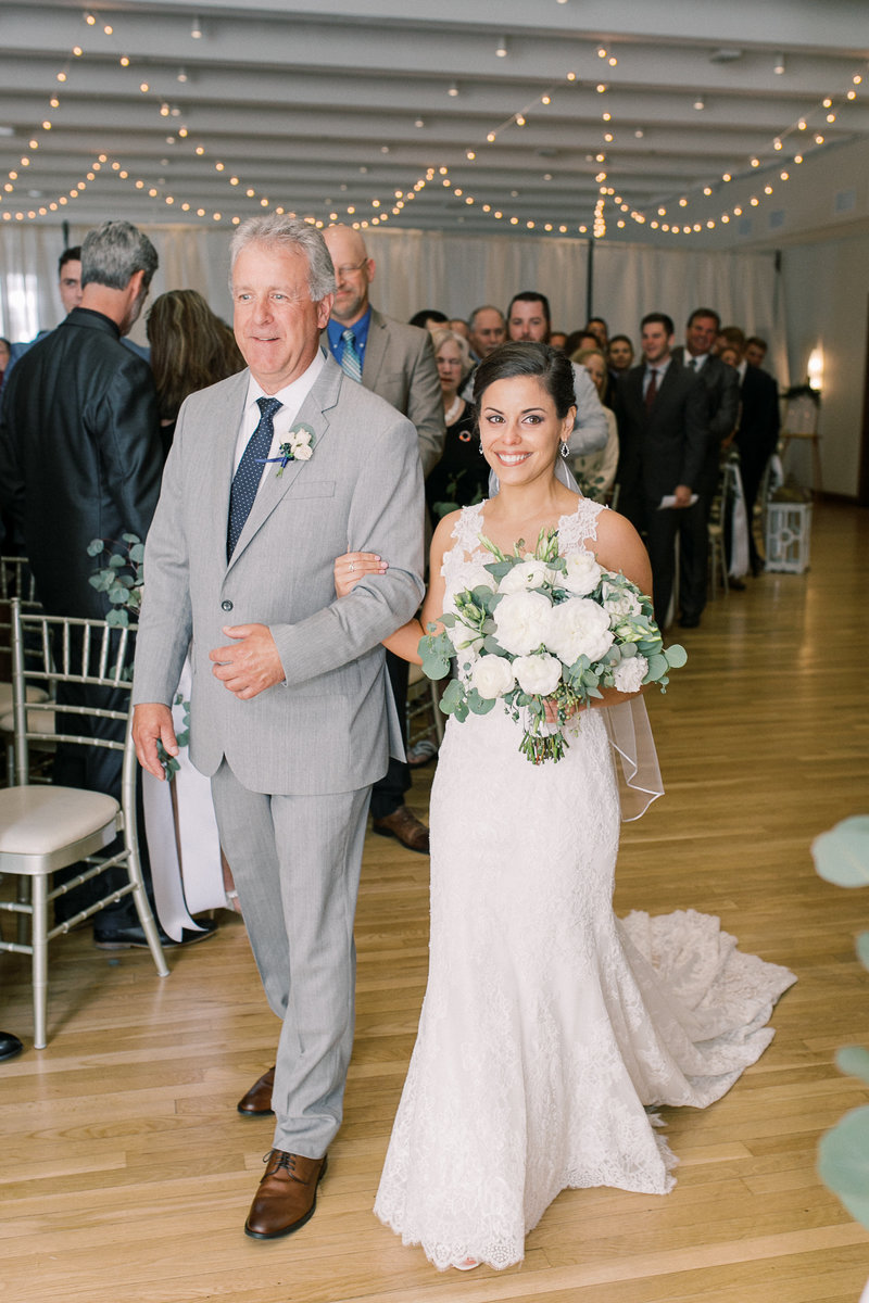 A bride and her father walk down the aisle at the Center in Cincinnati Ohio