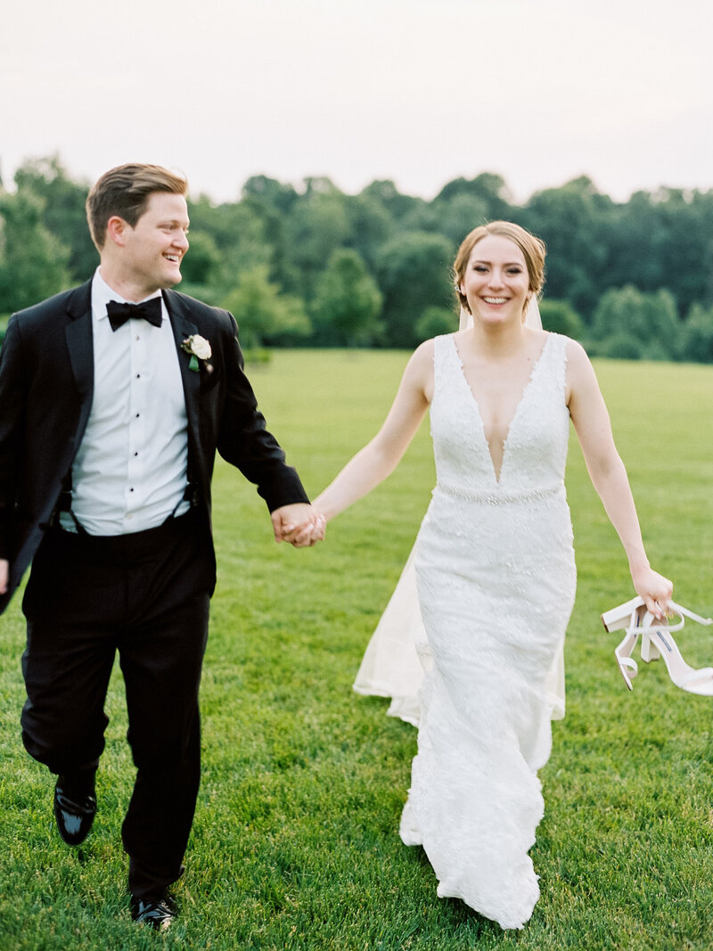 Bride and Groom running to reception
