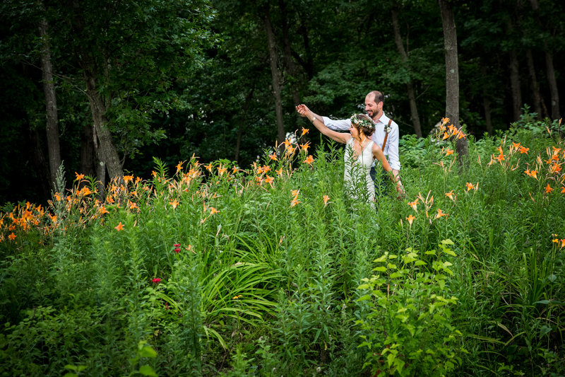 couple dancing in flowers playful wedding