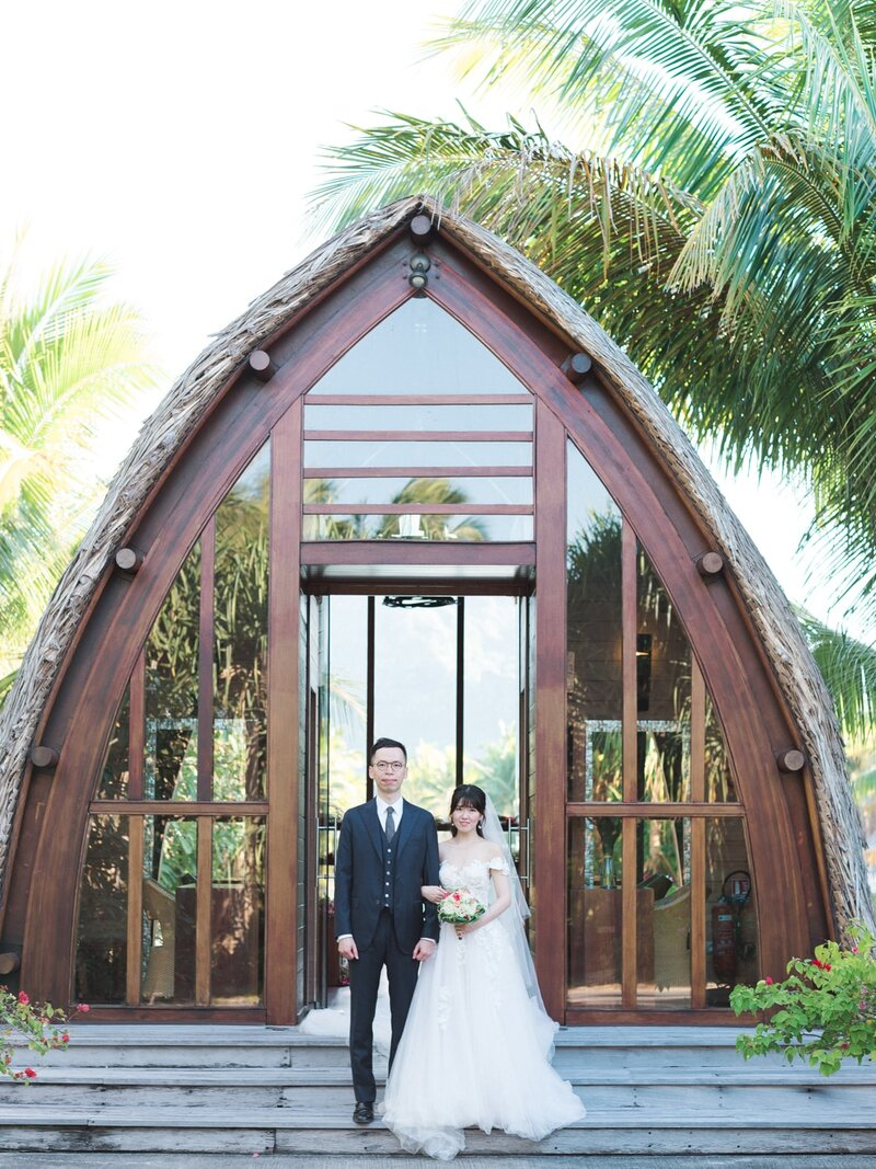 Bride and groom in front of the church in the Four Seasons Bora Bora after the elopement ceremony
