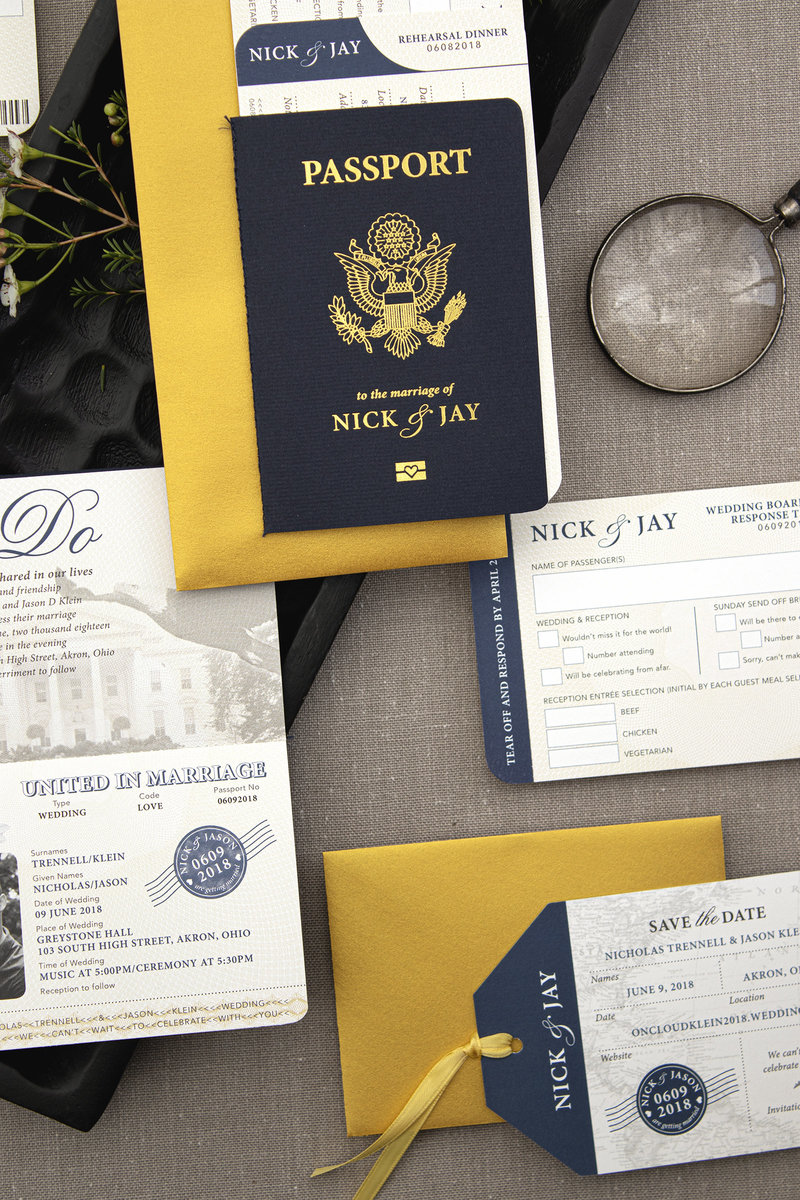Full suite of the passport travel wedding invitation featuring Gold Foil and travel boarding pass.