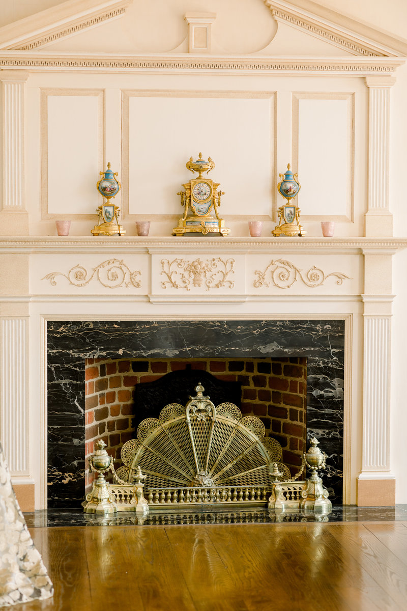 richmond wedding photographer, fireplace with luxury adorning items in wedding venue