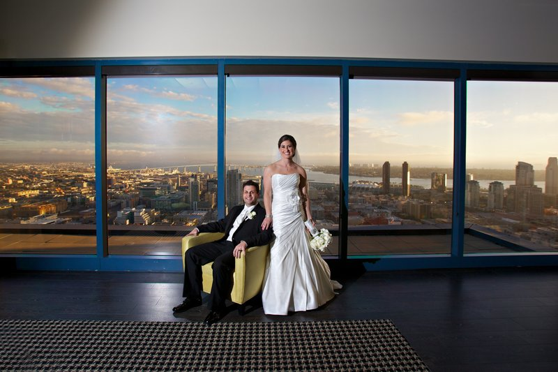Bride and Groom at The University Club with San Diego Skyline behind them