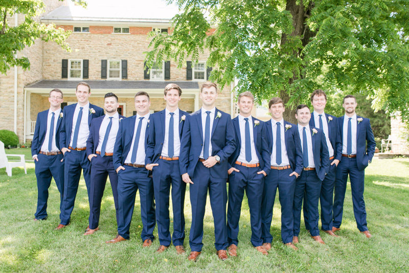 groomsmen in navy suits at springfield manor winery and distillery wedding by costola photography