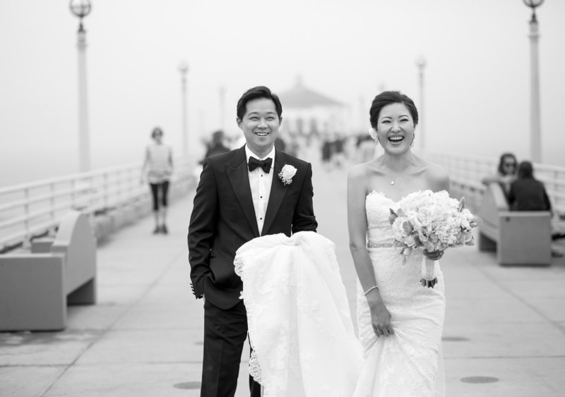 couple posing together on Manhattan Beach pier