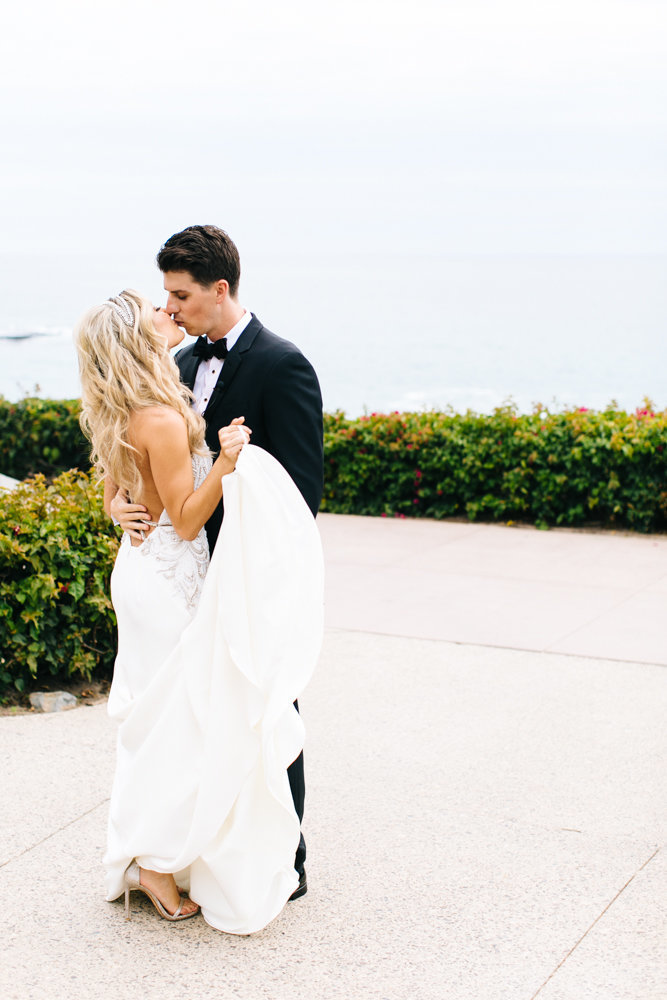 bride and groom kissing during their first look at the montage resort and spa in laguna beach