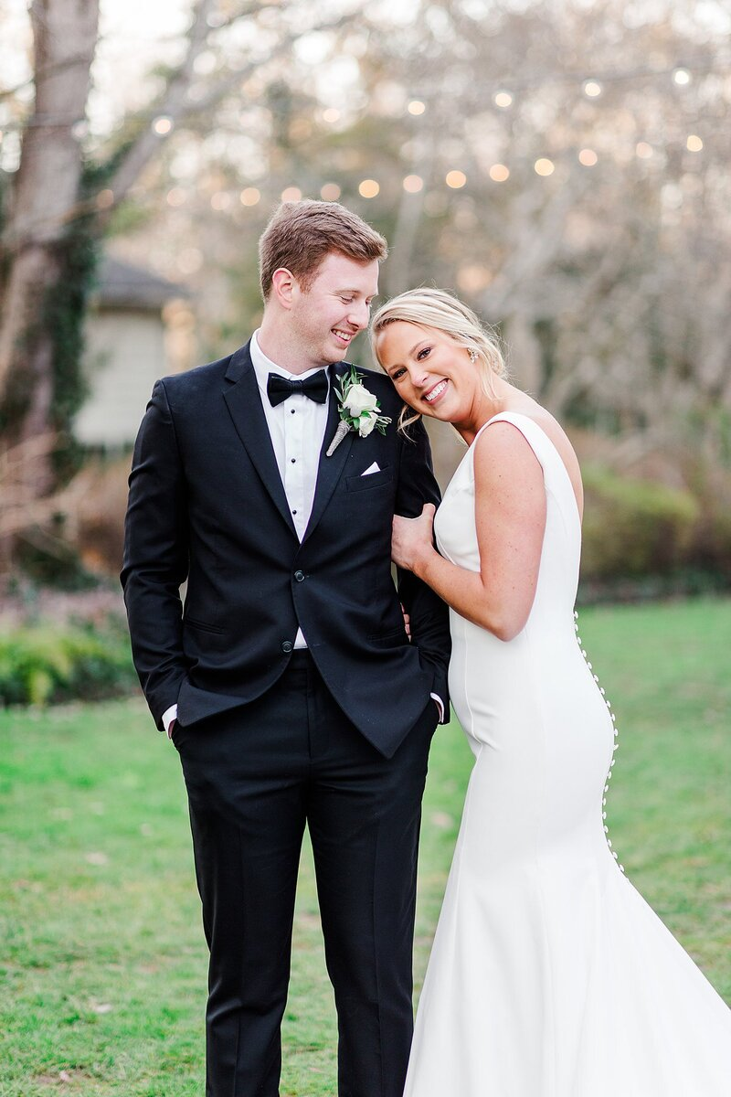 bride resting head on groom's shoulder by Knoxville Wedding Photographer, Amanda May Photos