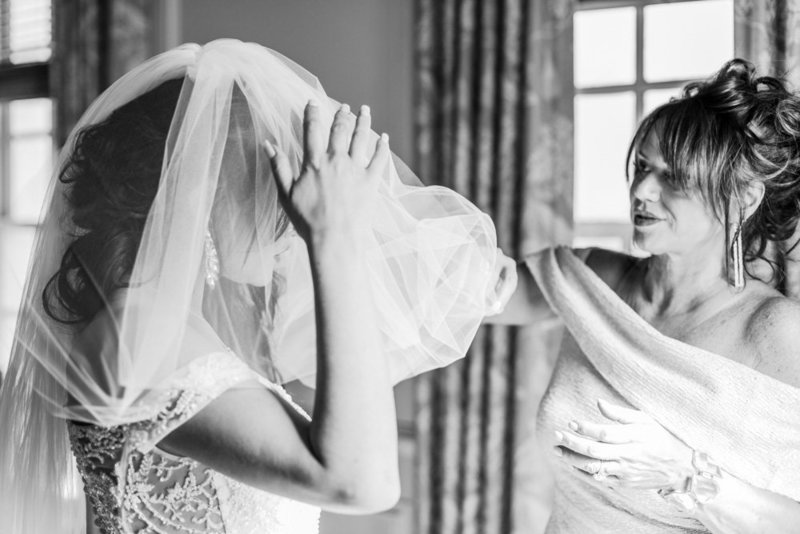 mother of bride helping with veil at great marsh estate wedding in northern virginia by costola photography