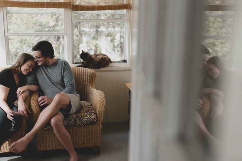 Cozy couple in house during engagement shoot