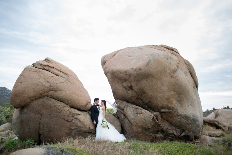 Bride and Groom Next to Large Rocks on Private Estate Wedding