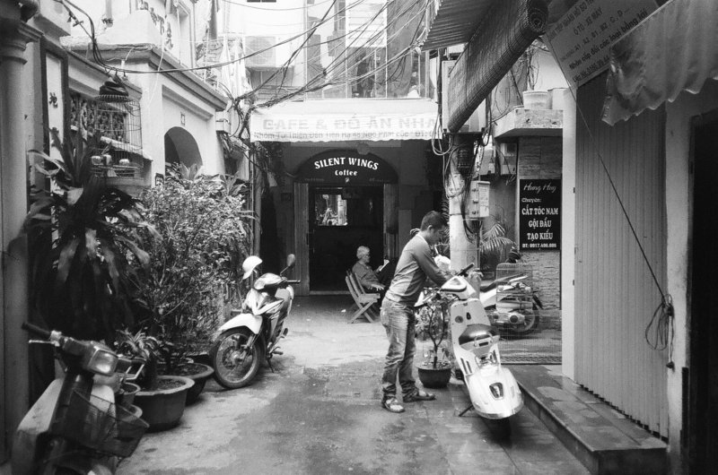 Black and white images of a cafe in the streets of Hanoi